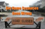 A road closed barricade blocks a flooded street in Ocean Isle Beach, N.C., Sunday, Oct. 4, 2015. Numerous roads in Brunswick and New Hanover counties in southeastern North Carolina are impassable as a storm system that inundated South Carolina moves north. (Mike Spencer/The Star-News via AP)  LOCAL TELEVISION OUT; LOCAL INTERNET OUT; MANDATORY CREDIT
